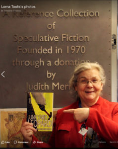 a photo of Lorna Toolis smiling as she was inducted into the Canadian Science Fiction and Fantasy Hall of Fame